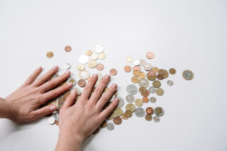 person-holding-silver-round-coins