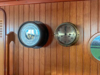 To the right of the instrumentation is a porthole to the shower